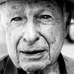 This is a black and white headshot of Playwright, Peter Brook.