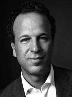 This is a black and white photo of Mark Lubell, Executive Director of the International Center of Photography.