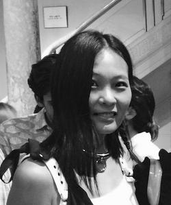 A black and white photo of poet and writer Sarah Wang.